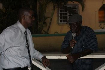 Hon Fahie listens to a concern of a resident. Photo: VINO