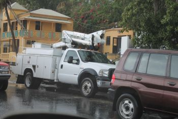 A reliable source within the BVI Electricity Corporation (BVIEC) confirmed that a crane came into contact with cables belonging to both or one of the communication networks and subsequently pulled down several electrical cables and poles belonging to the BVI Electricity Corporation. Photo: VINO