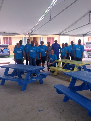 Flow also assisted in the building and painting of lunch benches for students of Elmore Stoutt High School. Photo: Provided