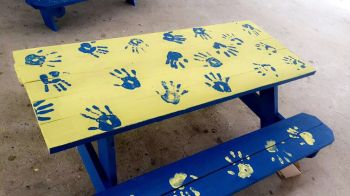 One of the lunch benches built and painted in a collaborative effort among members of Rotary Club of Road Town, employees of Flow and students of Elmore Stoutt High School. Photo: Provided
