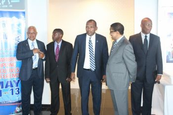Hon Vanterpool mingling with some of the delegates and officials prior to the start of the opening ceremony. Photo: VINO