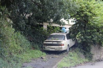 Some of the derelict vehicles along Ridge Road in Tortola. Photo: VINO