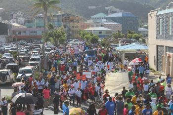Thousand of residents marching against the Bill that will affect the territory's main economic pillar. Photo: VINO