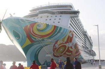 The Norwegian Getaway, which made its inaugural visit this morning April 29, 2015 is a 153, 000 ton ship and brought some 4000 passengers to the territory, hundreds of which streamed into the newly built passenger terminal and welcome centre. Photo: VINO