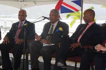 Leader of the Opposition Hon Ralph T. O'Neal giving his remarks at the opening of the expanded cruise pier. Left is Chairman of the BVI Ports Authority Board, Mr J. Edward de Castro while right is Managing Director of the BVI Ports Authority, Mr Claude O. Skelton Cline. Photo: VINO
