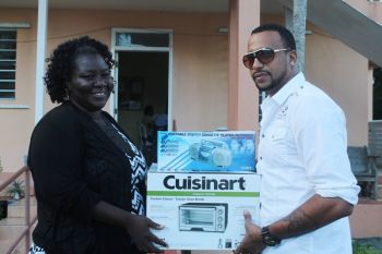The Rainbow Children's Home located in Lower Estate, Tortola was the proud recipient of a toaster oven and a radio set compliments of Club Opium, Showtime Band and Awesome Crew Entertainment System. Photo: VINO