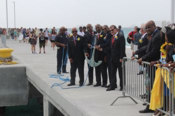 From left: Chairman of the BVI Ports Authority Board, Mr J. Edward de Castro, Managing Director of the BVI Ports Authority, Mr Claude O. Skelton Cline, Premier Dr The Hon D. Orlando Smith, Minister for Communications and Works Hon Mark H. Vanterpool and Governor of the Virgin Islands John S. Duncan at the symbolic 'dropping of the anchor' to mark the official opening of the expanded cruise pier. Photo: VINO