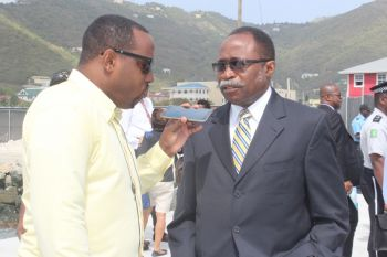 Chairman of the Virgin Islands Party Hon Julian Fraser RA (R3) seen here being interviewed by a member of the media at the opening of the expanded cruise pier on April 29, 2015. Photo: VINO