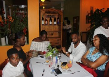 Darrio Prescod and some of the staff members of Road Town Wholesale Limited during the charity dinner. Photo: VINO