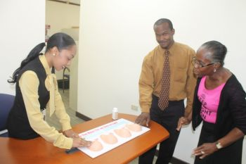 Staff being guided on the steps of checking the breast. Photo: VINO