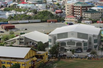 Many persons on social media are in support of the Sir Rupert Briercliffe Hall, left, being torn down and rebuilt to promote the arts and facilitate other events that now have to be held at the Multi-Purpose Sports Complex, right. Photo: VINO