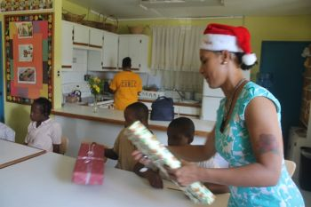 Perez helping to distribute the gifts. Photo: VINO