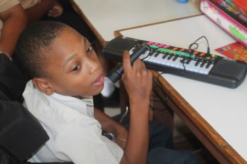 This young lad trying out his musical instruments. Photo: VINO