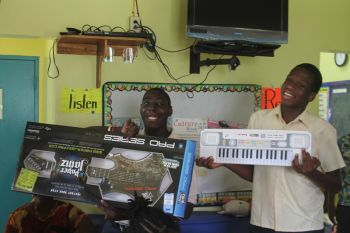 Happy with their musical instruments from Digicel BVI. Photo: VINO