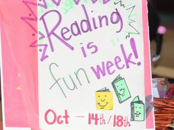 Students, parents and teachers at a local school engaged in reading exercises yesterday as part of the week-long activities of 'Reading is Fun Week'. Photo: VINO