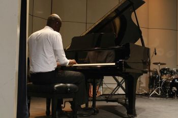 Dame is a self taught musician. The piano and keyboards are his favourite instruments. Photo: Provided