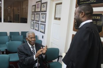 Creque chatting with Leader of the Opposition Hon Ralph T. O'Neal OBE (R9). Photo: VINO