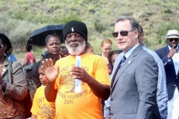 A resident of Salt Island speaking to Governor Duncan about the process of harvesting the salt from the salt pond. Photo: VINO