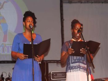 The Callaloo Poets led by April Glasgow reciting a poem during the Emancipation Festival Village opening ceremony held on Monday July 31, 2017. Photo: VINO