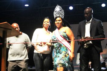 VG Easter Festival queen Sylvanna Charles and relative of the late Darwin George, Carolann P. George, cut the ribbon to symbolically declare the Virgin Gorda Easter Festival open. Photo: VINO