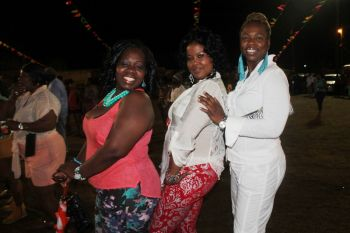 Three patrons of the VG Easter Festival opening night pose for a photo for Virgin Islands News Online. Photo: VINO