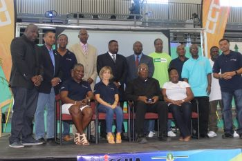 Executives and members of the BVI Chamber of Commerce and Hotel Association (BVICCHA) take a photo op at the CCT Buy BVI Trade Expo on Saturday April 16, 2016. Photo: VINO