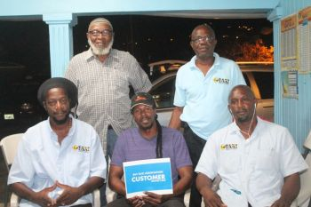 In photo are some of the elected members of the BVI Taxi Association. Seated from left are Secretary Mr Danny Smith, President Karl 'Dub' Scatliffe and Assistant Treasurer Julio 'Sam' Henry. Standing are Public Relations Officer Sydney Dougan and Vice President Musa Muhammad. Photo: VINO