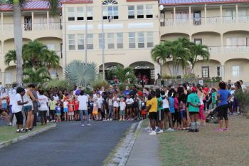 Participants for the one-mile race receive instructions from race director Stephanie Russ-Penn. Photo: HLSCC