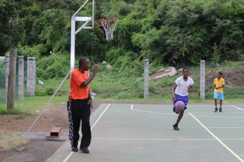 Coach McLean at work with youths at the Sea Cows Bay basketball court. Photo: VINO