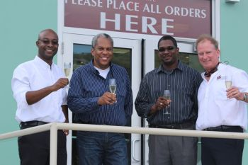 These gentlemen share a toast during the opening [L-R Dwaine Williams (General Manager of Caribbean Cellars), Colin O'Neal, Johnathan Baptiste, Richard Berry (President of Caribbean Cellars).] Photo: VINO