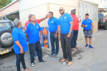 Staff of Delta Petroleum at one of their motorcade stops yesterday, July 7, 2016. Regional General Manager Mr Bevis A. Sylvester is third from right. Photo: Mikhail Mohamed