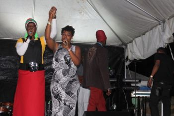 Local artist Sistah Joyce and one of her back up singers take a bow after a well received performance. Photo: VINO