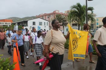 Participants of the street march that heralded the start of the 20th Memorial Celebration of Honourable H. Lavity Stoutt - A Nation Builder, yesterday March 2, 2015. Photo: VINO