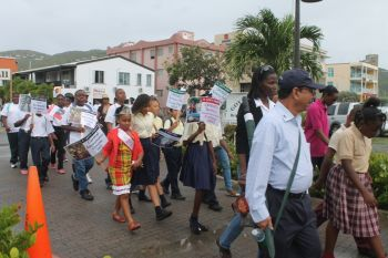 Little Princess 2014 Afyah Frett was among those who participated in the street march that heralded the start of the 20th Memorial Celebration of Honourable H. Lavity Stoutt - A Nation Builder, yesterday March 2, 2015. Photo: VINO