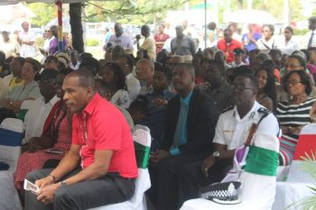 Minister for Communications and Works Hon Mark H. Vanterpool (left) among the audience yesterday, March 2, 2015, at the ceremony held at the Central Administration Complex. Photo: VINO