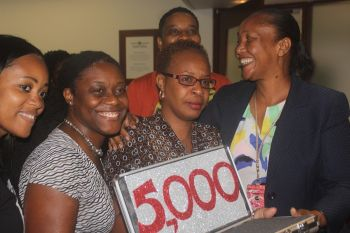 First Digicel 'Bring the Beat' winner, Prudencia E. Walters is surrounded by her workmates. Photo: VINO