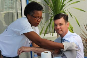 Director at Caribbean Insurance (BVI) Limited, Mr Brian Jermyn gets his blood pressure checked. Photo: VINO