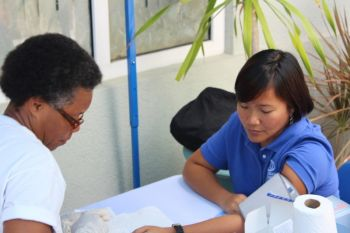 A staff member of Caribbean Insurers Limited going through the screening exercise. Photo: VINO