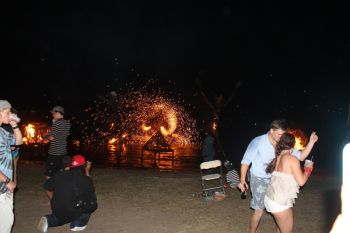 The hundreds that gathered at the bars and dinners that stretched along the beach at Trellis Bay patiently awaited the usual fireworks display amidst the statues of moko jumbies and the unique fire balls. Photo: VINO