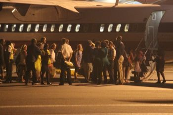 Passengers board the American Eagle aeroplane for it's final flight out of the Virgin Islands last evening March 31, 2013. Photo: VINO