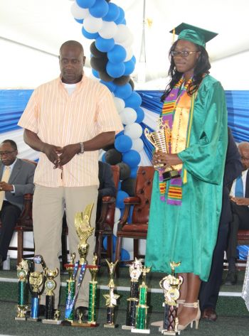 Valedictorian Zoyia T. Ettienne, the BVI Seventh-day Adventist School's top student, with a perfect GPA of 4.3, with her many trophies. Photo: VINO
