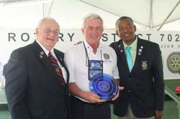 President of the Rotary club of Tortola, Mr Sam Welch receives the award on behalf of his club. Photo:VINO