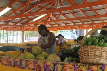 Local farmers with their produce in the permanent structure at the market. Photo: VINO