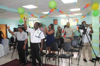 Raising a toast for new Superintendent of Police Jacqueline E. Vanterpool. Photo: VINO
