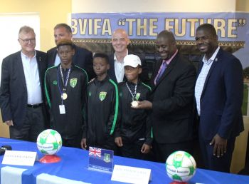 National U-15 Footballers, from front left: Gerald Fredericks, Ryan Lettsome and Azarni Callwood with, from back left: President of the BVI Football Association, Andrew Bickerton; President of CONCACAF, Victor Montagliani; President of FIFA, Giovanni V. Infantino; Premier and Minister of Finance of the Virgin Islands Hon Andrew A. Fahie (R1) and Minister responsible for Sports, Hon Natalio D. Wheatley (R7). Photo: VINO