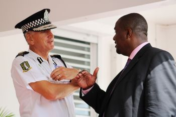 Premier and Minister of Finance Honourable Andrew A. Fahie (R1), right, speaks with Commissioner of Police Michael B. Matthews prior to the re-opening ceremony of the West End Police Station on August 15, 2019. Photo: VINO