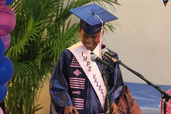 Valedictorian K'Jae Thompson flashes a smile while on stage at the graduation exercise. Photo: VINO