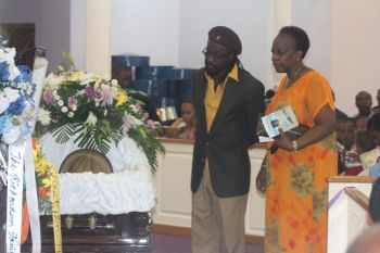 Enriquito Rhymer (left) did the honour of reading the Eulogy at the funeral of Uncle Pouie. Photo: VINO