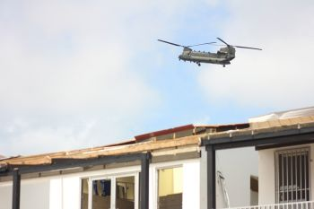 A British military helicopter bringing in relief supplies to Tortola days after Hurricane Irma devastated the Virgin Islands. Photo: VINO