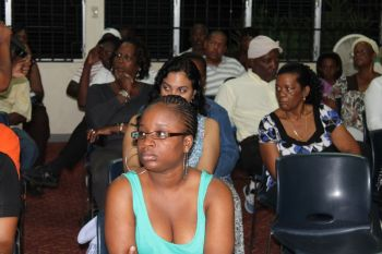 Persons paying rapt attention to Hon. Julian Fraser, RA at the community meeting on May 30, 2013. Photo: VINO